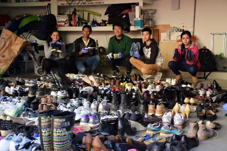 Juniors+Josiah+Willis%2C+Michael+Lin+and+William+Zhang+collect+shoes+for+Step+On+Poverty.