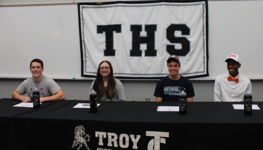 Seniors Christopher Murphy, Emily Moharter, Theodore Bleich, and Brandon Davis posing with their Letters of Intent.