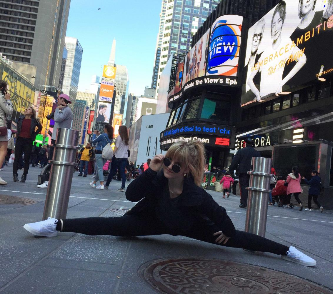 Bonich does the splits in Times Square.