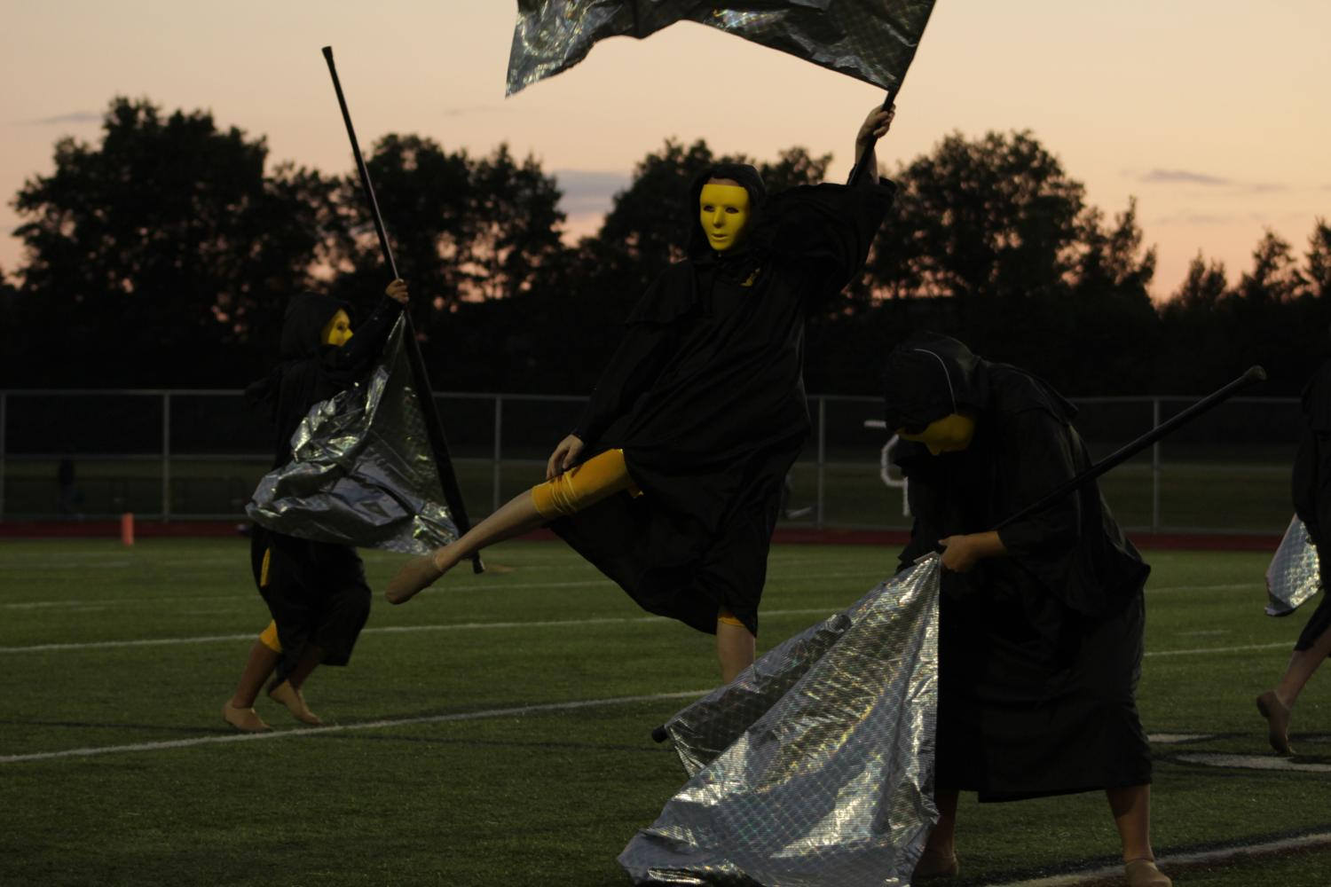 Color guard changes costumes mid-performance.