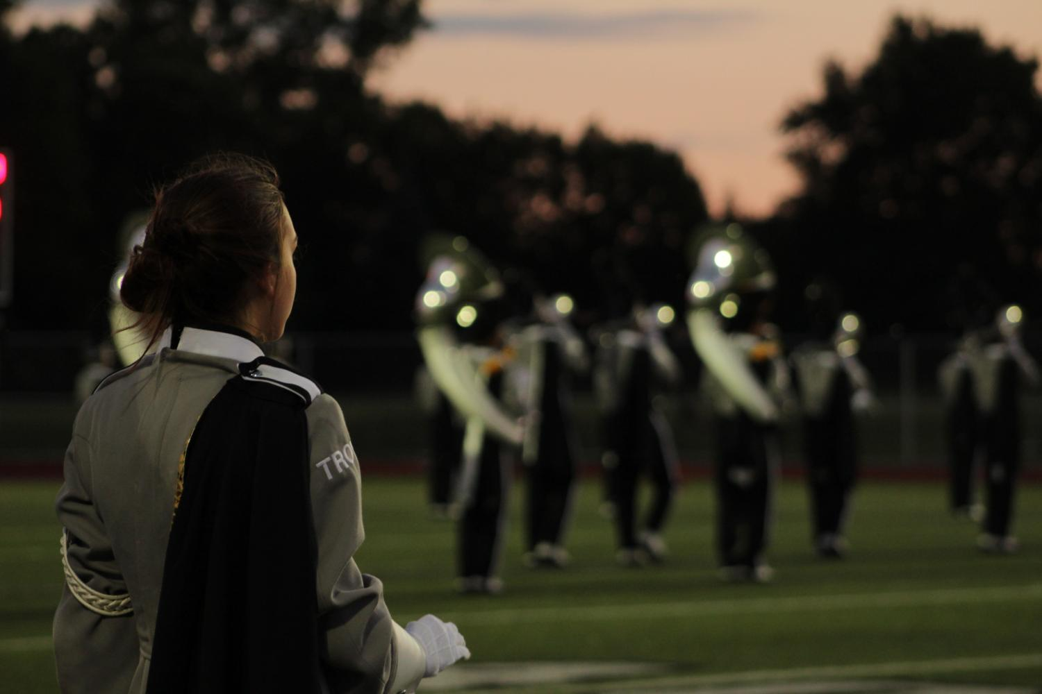 Drum Major, senior Natalie Fisher, leads the marching band during the halftime performance.