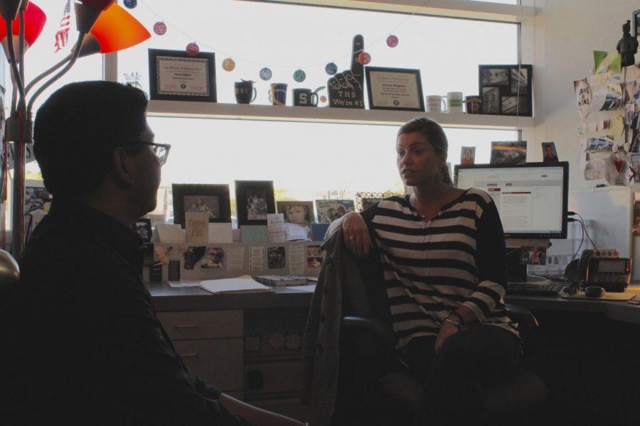 Counselor Jesse Allgeier talks to junior Hemanth Tadepalli.