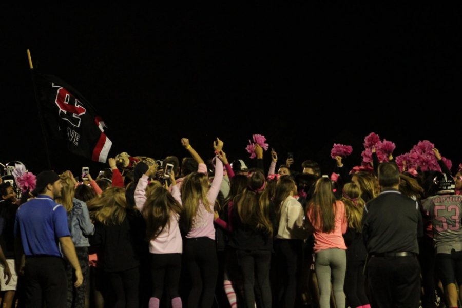 The student section joined the team on the field for celebration after the game.