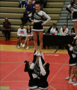 The cheer team competes at Athens High School.
