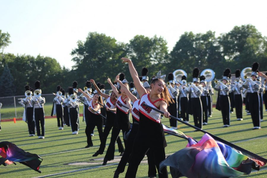 Senior+Olivia+Tu+performs+in+the+band+pre-game+show.