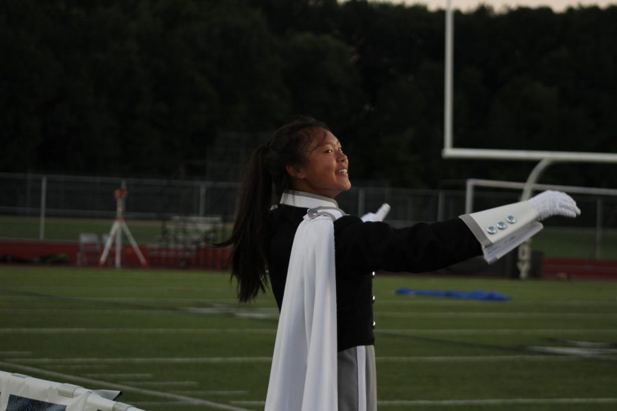 Junior Teresa Chen conducts the band while looking at senior drum major Nabeel Mohammad.