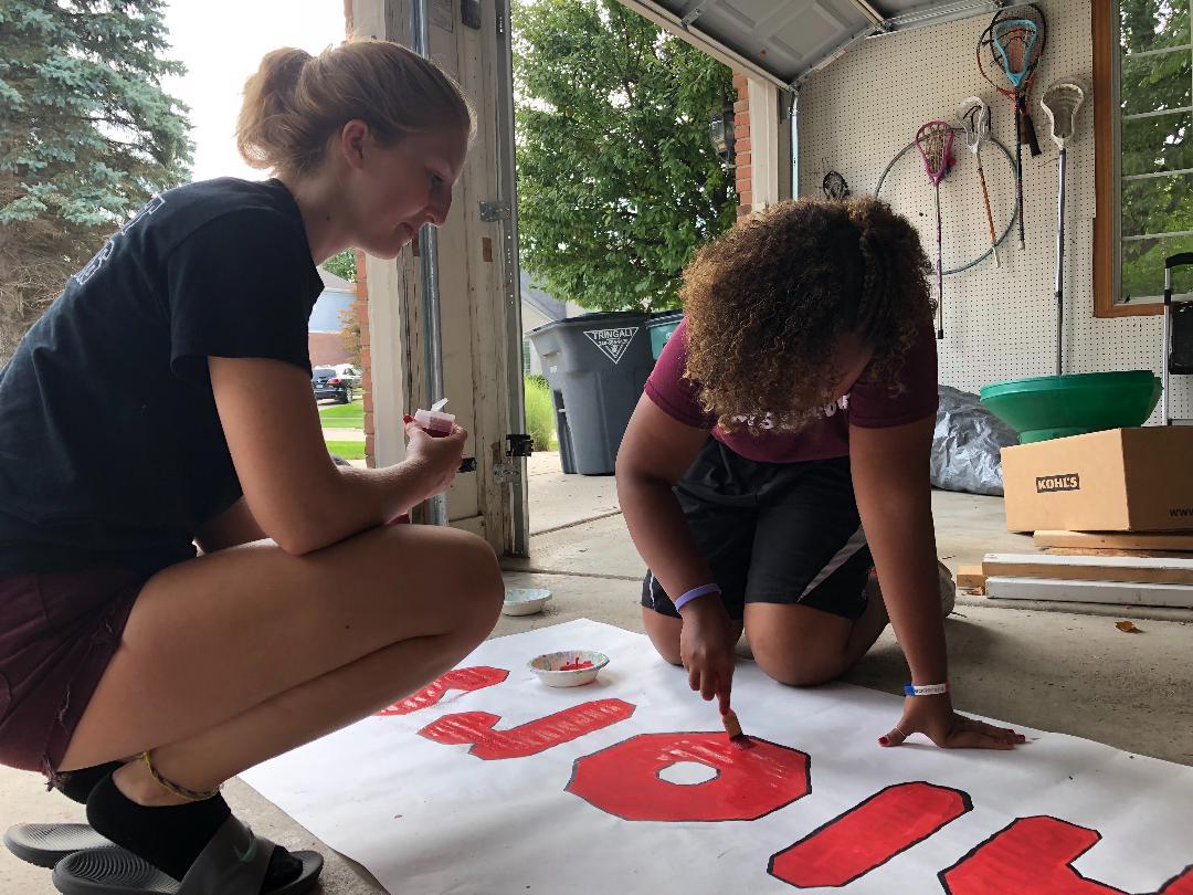 Seniors Emily Olson and Caitlin Smith work on their class float.