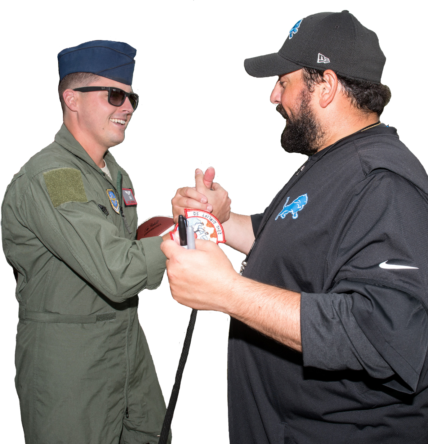 Lions coach Matt Patricia shakes hands with active duty soldier.