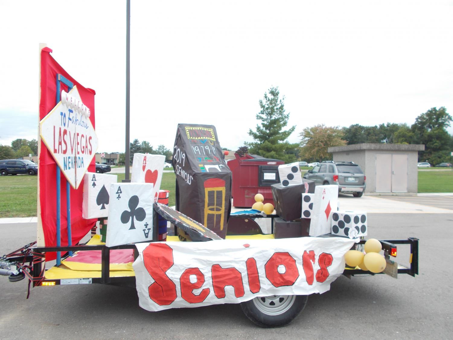 The seniors' Las Vegas-themed float features life-sized cards and gambling dice.