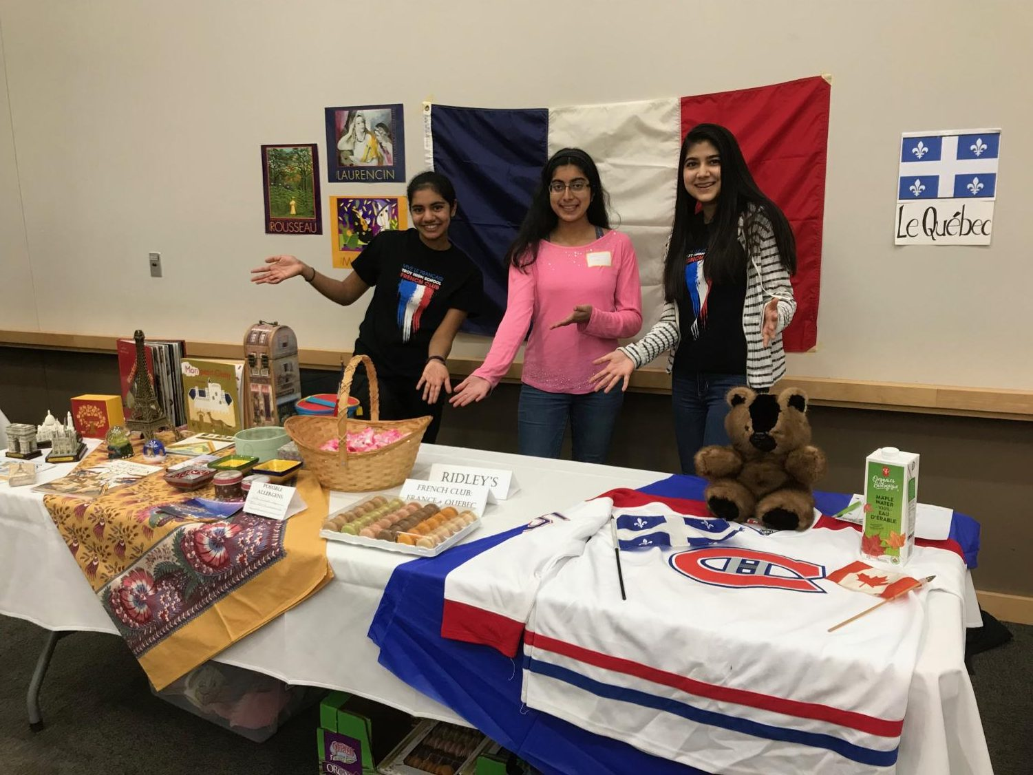 French Club with their table representing France and the French-speaking Canadian province of Quebec.