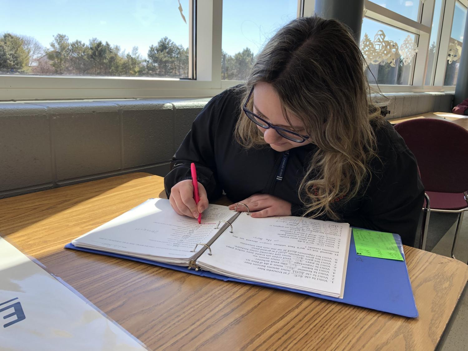 Sophomore Lily Renke studies for the upcoming PSAT test. Freshmen and sophomores will take the test during the week following Spring Break.