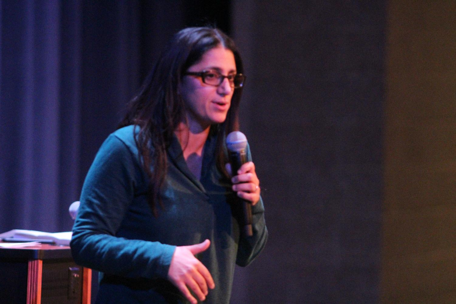 Dr. Mona Hanna-Attisha speaks to students during fifth hour in the auditorium.