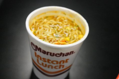Students competed eating Maruchan Instant Lunch ramen.