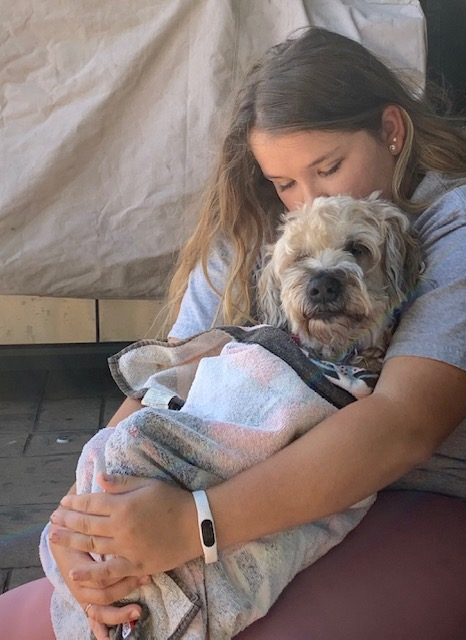 Owner Lola Pinneo hugs her dog Lucy